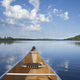 Canoe on calm northern Minnesota lake in the morning during summer - PhotoDune Item for Sale