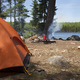 Campsite in northern Minnesota with orange tent and campfire - PhotoDune Item for Sale