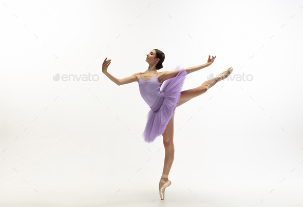 Young graceful tender ballerina on white studio background - Stock Photo - Images