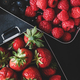 Flat-lay of fresh berries in lunchboxes over dark background - PhotoDune Item for Sale