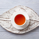 Cup of tea on wooden tray leaf shaped. Grey background. Top view - PhotoDune Item for Sale