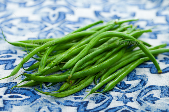 Green beans on blue and white background. Close up. - Stock Photo - Images