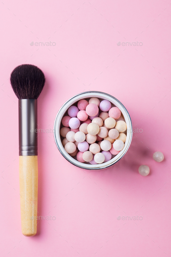 Pearl make up powder with brush on pink pastel background. Top view. - Stock Photo - Images