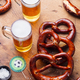 Beer, salted pretzels on wooden table background. - PhotoDune Item for Sale