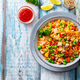 Asian fried rice, Cantonese cuisine. Blue wooden background. Top view. Copy space. - PhotoDune Item for Sale