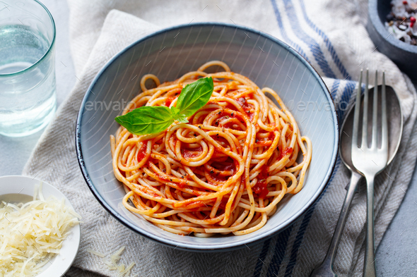 Pasta, Spaghetti with Tomato Sauce and Fresh Basil in a Bowl. Close up. - Stock Photo - Images