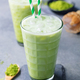 Matcha iced green tea. Grey background. Close up. - PhotoDune Item for Sale