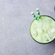 Matcha ice green tea in glass. Grey stone background. Top view. Copy space - PhotoDune Item for Sale