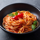 Pasta, spaghetti with tomato sauce in black bowl. Grey stone background. Close up. - PhotoDune Item for Sale