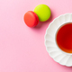 Macaroons dessert and cup of tea on pink pastel background. Top view. Copy space. - PhotoDune Item for Sale