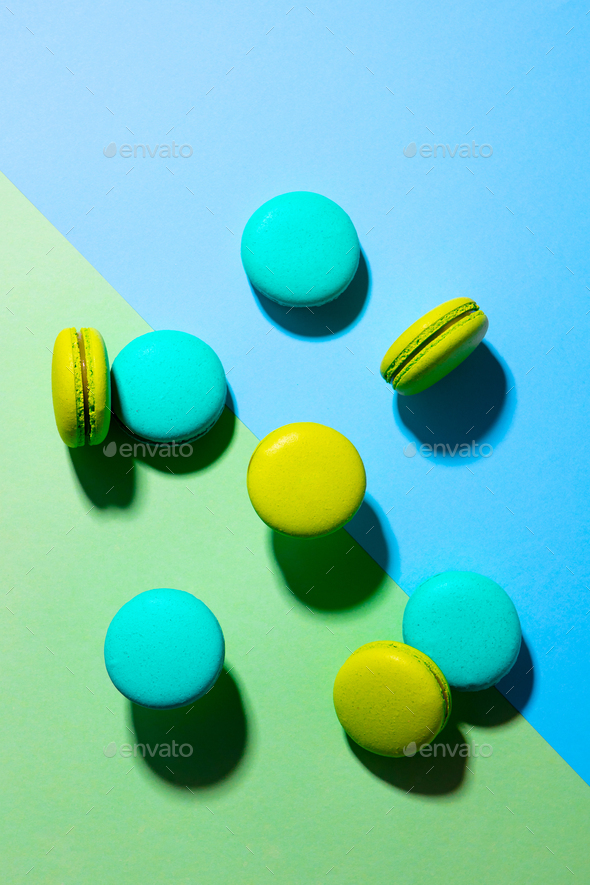 Macaroons Dessert on Colorful Background. Top view. - Stock Photo - Images