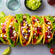 Taco with Mixed Vegetables, Beans on Cutting Board. Grey Background. Top view. - PhotoDune Item for Sale