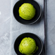 Green Tea Matcha Ice Cream Scoop in Bowl on a Grey Stone Background. Top view. - PhotoDune Item for Sale
