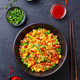 Asian Fried Rice with Egg and Vegetables. Dark Stone Background. Top view. - PhotoDune Item for Sale