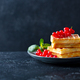 Belgian waffles with fresh red currant berries. Dark slate background. Copy space - PhotoDune Item for Sale