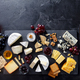 Cheese Assortment on Slate Cutting Board with Wine. Grey Background. Top View. Copy Space. - PhotoDune Item for Sale