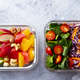 Lunch Box with Vegetables, brown rice and fruits salad. Healthy eating. Grey background. Top view. - PhotoDune Item for Sale
