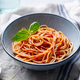 Pasta, Spaghetti with Tomato Sauce and Fresh Basil in a bowl. Grey Background. Close up. - PhotoDune Item for Sale