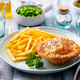 Meat Pie with French Fries on a White Plate. Wooden Background. Close up. - PhotoDune Item for Sale