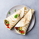 Wrap Sandwich with Grilled Vegetables and Feta Cheese on a Plate. Grey Background. Top View. - PhotoDune Item for Sale