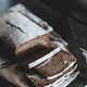 Healthy rye Swedish bread cut in slices over kitchen counter - PhotoDune Item for Sale