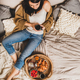 Young brunette woman sitting and having tasty breakfast in bed - PhotoDune Item for Sale