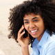 Close up african american young woman talking on cellphone outside - PhotoDune Item for Sale