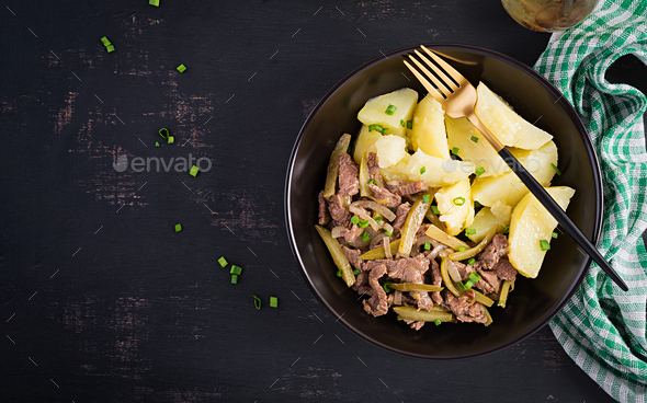 Stew beef, pieces of beef stewed with pickled cucumber in russian style. - Stock Photo - Images