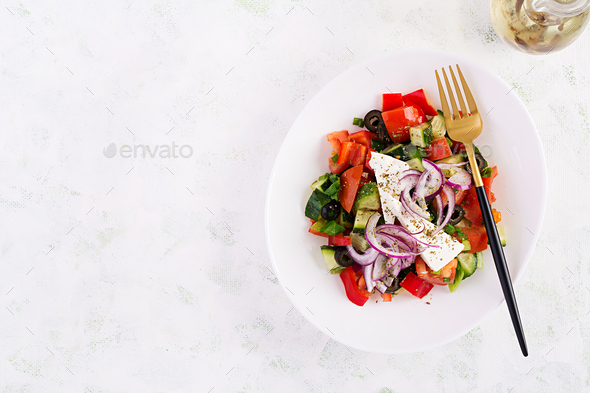 Greek salad  with fresh vegetables, feta cheese and black olives. - Stock Photo - Images