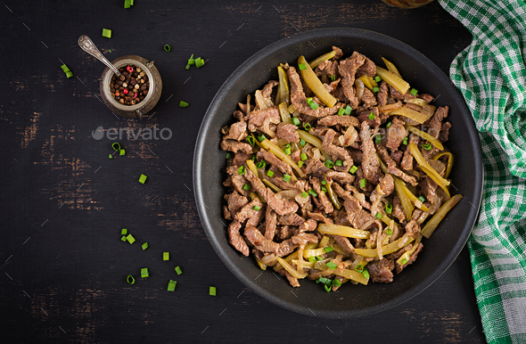 Stew beef, pieces of beef stewed in soy sauce with spices with pickled cucumber - Stock Photo - Images