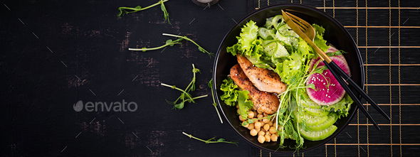 Buddha bowl dish with chicken fillet, chickpea, cucumber, radish,  fresh lettuce salad, pea sprouts - Stock Photo - Images
