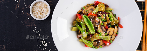 Stir fry vegetables with mushrooms, paprika, red onions and broccoli. - Stock Photo - Images