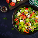Fresh salad with vegetables tomatoes, red onions, lettuce and quail eggs - PhotoDune Item for Sale