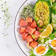 Ketogenic diet breakfast. Salt salmon salad with greens, cucumbers, eggs and avocado. - PhotoDune Item for Sale
