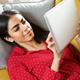 Persian woman at home using digital tablet - PhotoDune Item for Sale