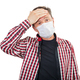 Adult male with a headache in a medical mask - PhotoDune Item for Sale