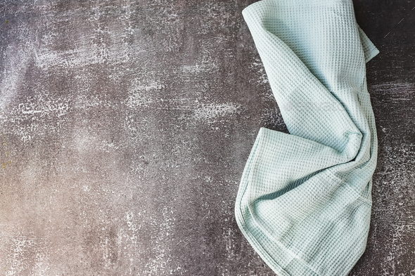 Kitchen stone table with towel. Gray backround. - Stock Photo - Images
