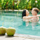 Couple in love kissing in swimming pool - PhotoDune Item for Sale