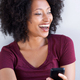 Close up young black woman laughing with mobile phone - PhotoDune Item for Sale