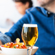 Glass of beer and chips on wooden table - PhotoDune Item for Sale