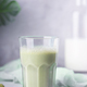 Green matcha latte with almond milk on a gray - PhotoDune Item for Sale