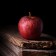 A red apple on black background, vertical - PhotoDune Item for Sale