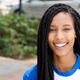 horizontal portrait of smiling young african american woman outside - PhotoDune Item for Sale