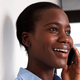 Close up african american lady talking on cell phone and smiling - PhotoDune Item for Sale