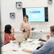 Young Businesswoman Giving Presentation in Meeting - PhotoDune Item for Sale