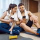 Love couple resting after fitness workout at home - PhotoDune Item for Sale