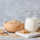Oat milk, flakes and cookies on wooden table - PhotoDune Item for Sale