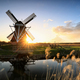 golden sunshine behind windmill in spring - PhotoDune Item for Sale