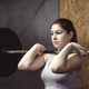 Strong muscular woman working out with a barbell - PhotoDune Item for Sale
