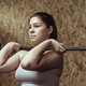 Young woman athlete working out with a barbell - PhotoDune Item for Sale